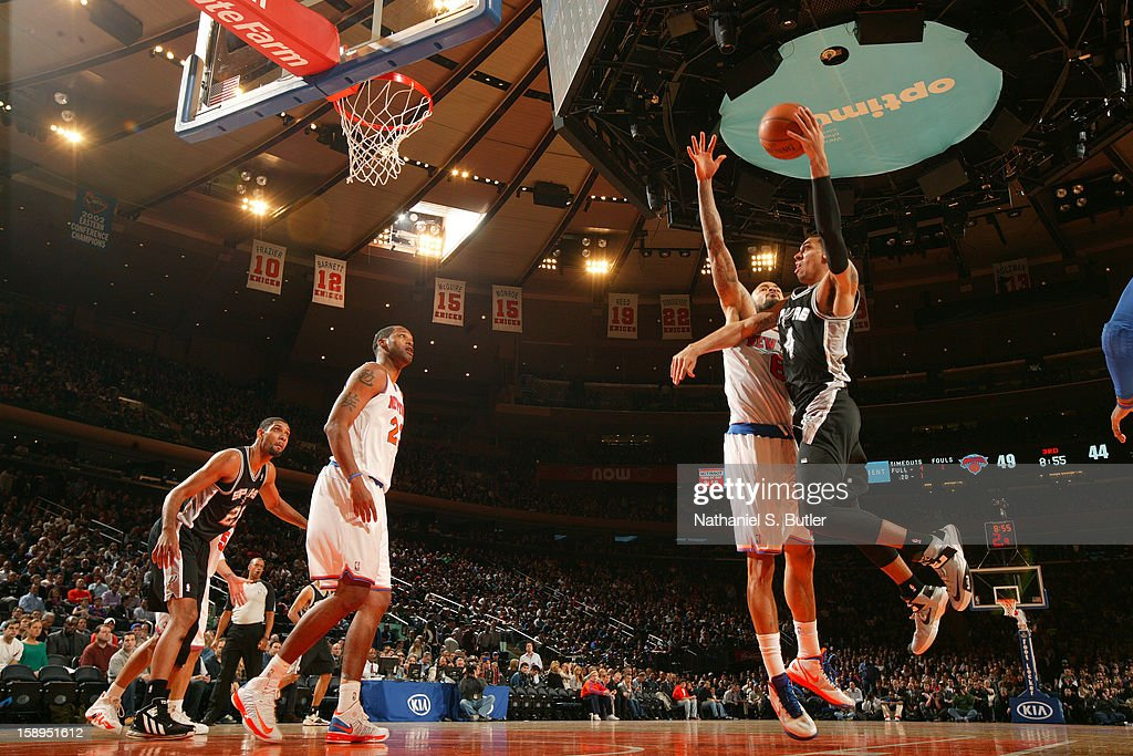 Danny Green #4 of the San Antonio Spurs shoots against <a gi-track='captionPersonalityLinkClicked' href=/galleries/search?phrase=Tyson+Chandler&family=editorial&specificpeople=202061 ng-click='$event.stopPropagation()'>Tyson Chandler</a> #6 of the New York Knicks on January 3, 2013 at Madison Square Garden in New York City.