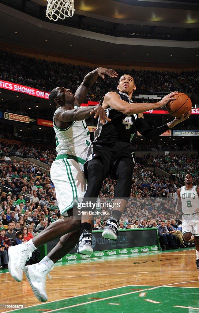 Danny Green #4 of the San Antonio Spurs shoots the ball against Brandon Bass #30 of the Boston Celtics on November 21, 2012 at the TD Garden in Boston, Massachusetts.