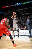 Danny Green of the San Antonio Spurs shoots the ball against the Houston Rockets during the game on December 28 2014 at the ATT Center in San Antonio...