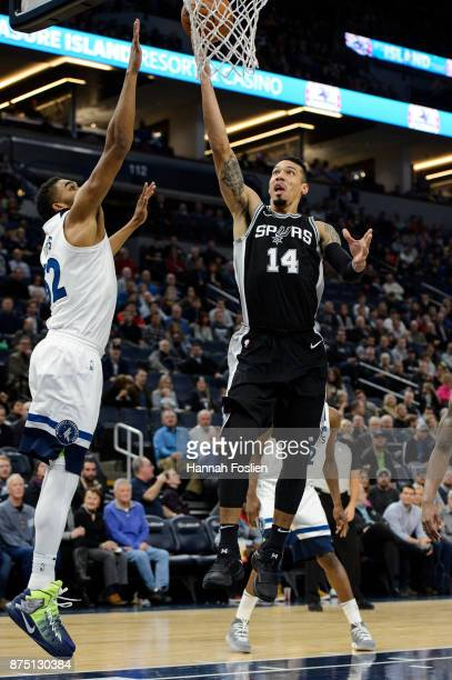 Danny Green of the San Antonio Spurs shoots the ball against KarlAnthony Towns of the Minnesota Timberwolves during the game on November 15 2017 at...