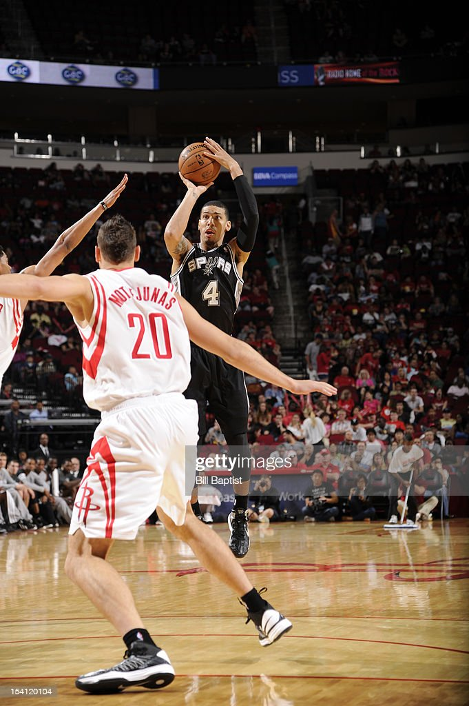 Danny Green #4 of the San Antonio Spurs shoots the ball over <a gi-track='captionPersonalityLinkClicked' href=/galleries/search?phrase=Donatas+Motiejunas&family=editorial&specificpeople=5561687 ng-click='$event.stopPropagation()'>Donatas Motiejunas</a> #20 of the Houston Rockets during a pre-season game on October 14, 2012 at the Toyota Center in Houston, Texas.