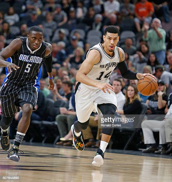 Danny Green of the San Antonio Spurs steals the ball from Victor Oladipo of the Orlando Magic at ATT Center on February 1 2016 in San Antonio Texas...