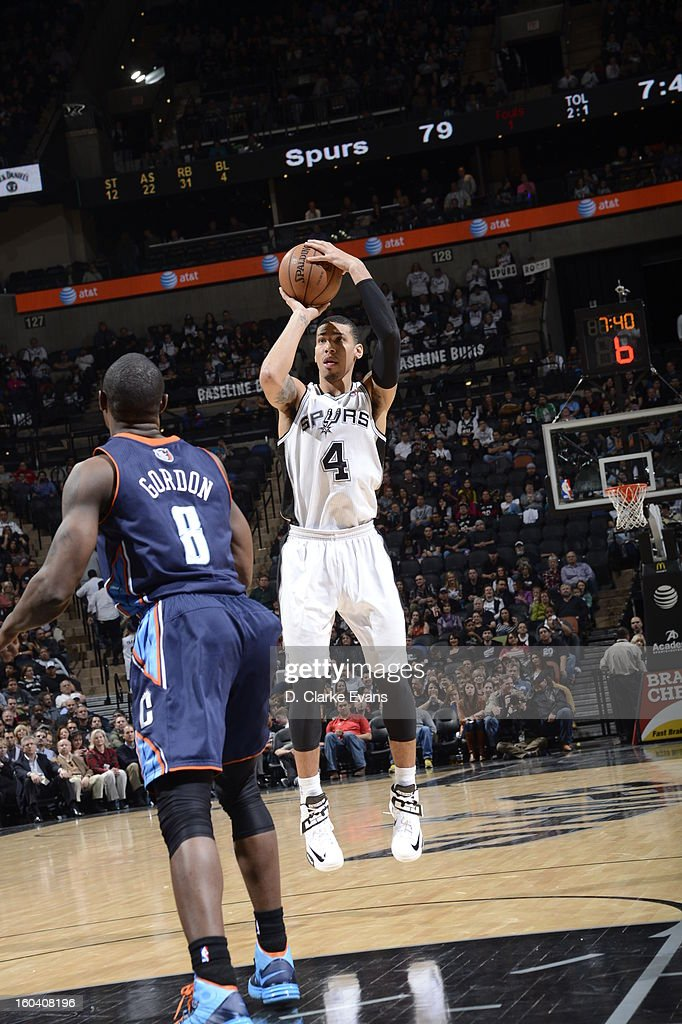 Danny Green #4 of the San Antonio Spurs take a jumpshot against Ben Gordon #8 of the Charlotte Bobcats on January 30, 2013 at the AT&T Center in San Antonio, Texas.