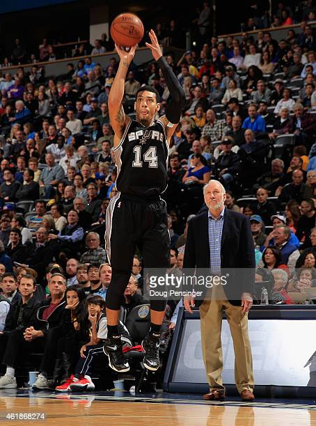 Danny Green of the San Antonio Spurs takes a jump shot against the Denver Nuggets as head coach Gregg Popovich of the San Antonio Spurs watches at...
