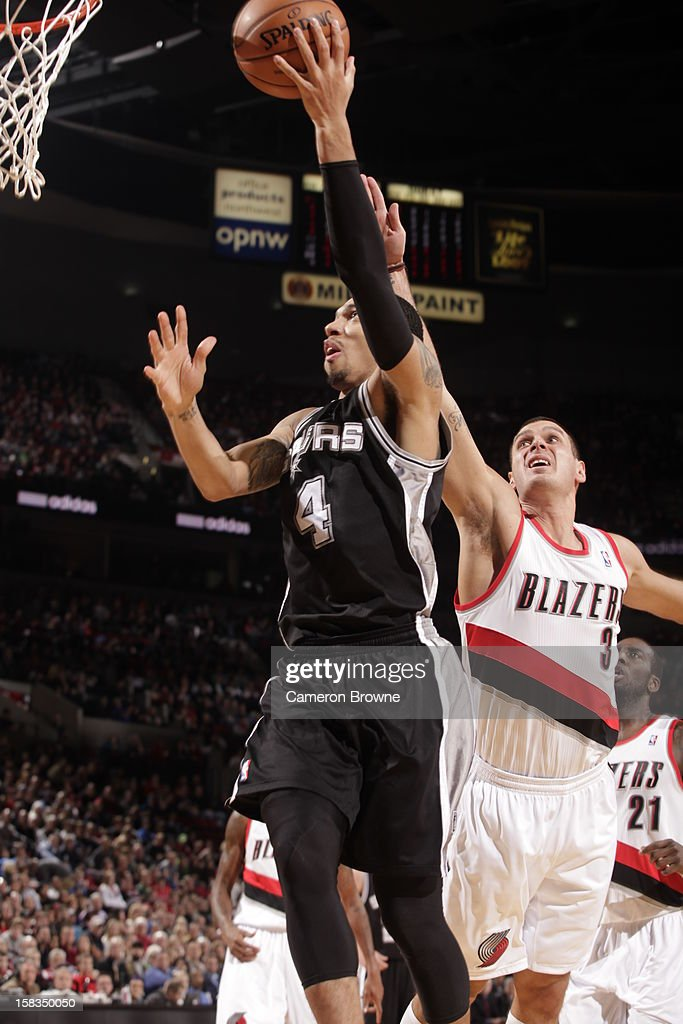 Danny Green #4 of the San Antonio Spurs takes the ball strong to the basket against the Portland Trailblazers on December 13, 2012 at the Rose Garden Arena in Portland, Oregon.
