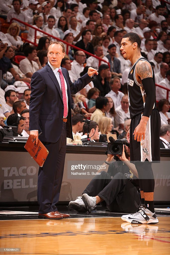 Danny Green #4 of the San Antonio Spurs talks with Assistant Coach Mike Budenholzer while playing against the Miami Heat during Game Two of the 2013 NBA Finals on June 9, 2013 at American Airlines Arena in Miami, Florida.