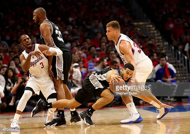 Danny Green#14 of the San Antonio Spurs falls against Blake Grifin of the Los Angeles Clippers as Clipper Chris Paul is screened by Boris Diaw during...