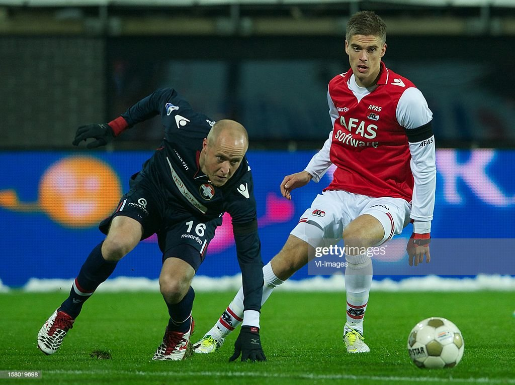 Danny Guijt of Willem II, Markus Henriksen of AZ during the Dutch Eredivisie match between AZ Alkmaar and Willem II at the AFAS Stadium on December 08, 2012 in Alkmaar, The Netherlands.