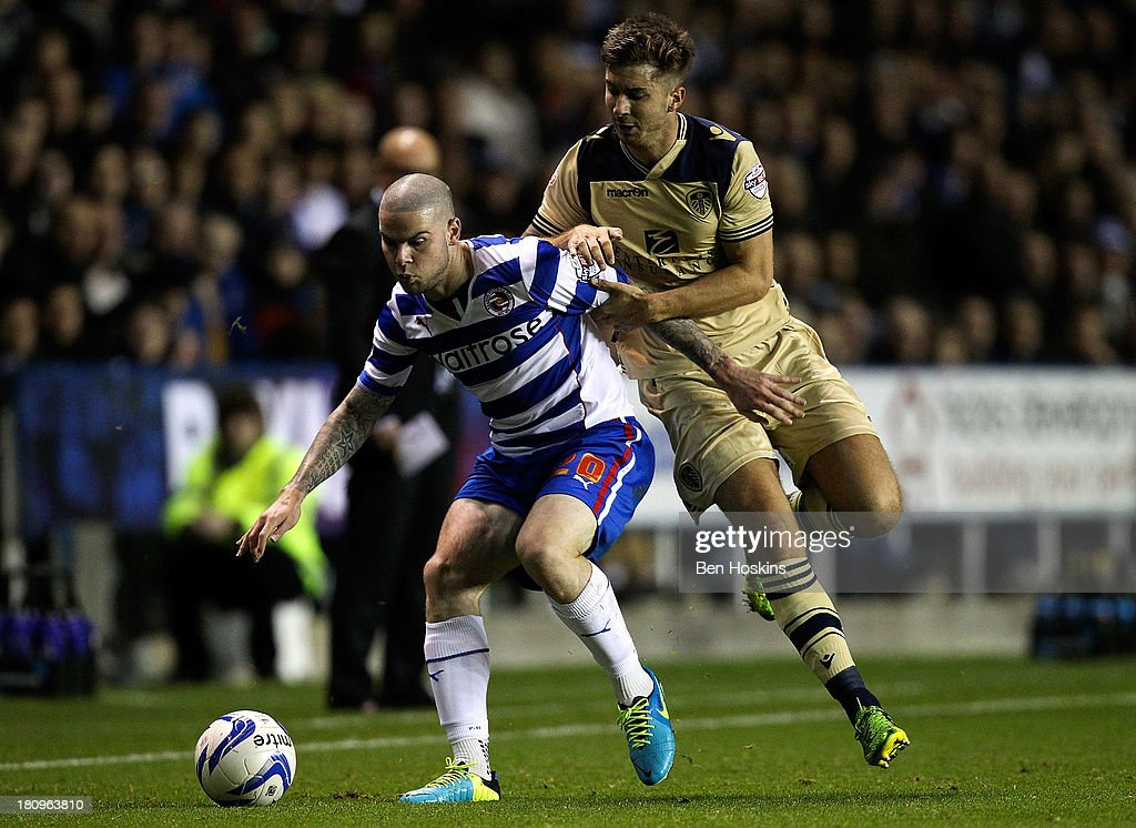 Danny Guthrie of Reading holds off the challenge of Michael Tonge of Leeds during the Sky Bet Championship match between Reading and Leeds United at Madejski Stadium on September 18, 2013 in Reading, England.
