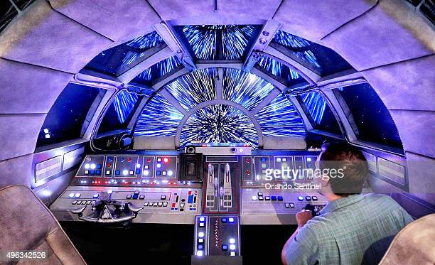 Danny Handke a creative design executive with Walt Disney Imagineering demonstrates the hyper reality of the cockpit in the new Star Wars Millennium...
