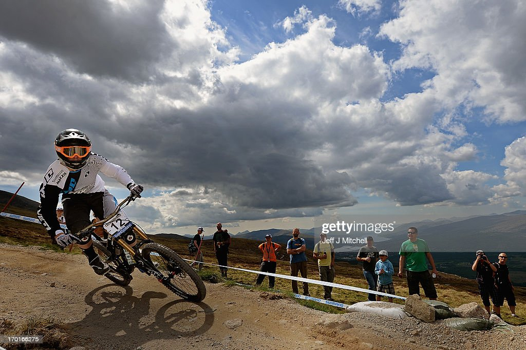 Danny Hart of Great Britain competes in the men's downhill qualifying round at the UCI Mountain Bike World Cup on June 8, 2013 in Fort William, Scotland.