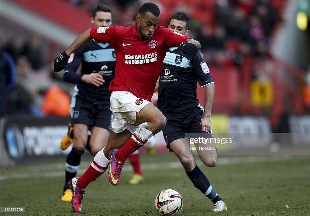 Danny Haynes of Charlton breaks away from Rhoys Wiggins of Burnley during the npower Championship match between Charlton Athletic and Burnley at the Valley on March 02, 2013 in London, England.
