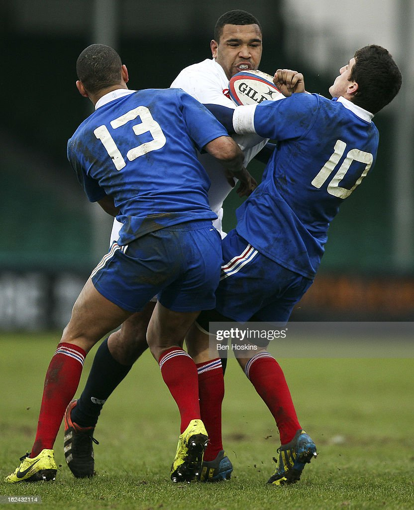 Danny Hobbs-Awoyemi of England is tackled by Gael Fickou (L) and Vincent Mallet (R) of France during the U20s RBS Six Nations match between England U20 and France U20 at the Sixways Stadium on February 23, 2013 in Worcester, England.