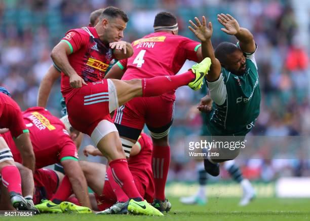 Danny HobbsAwoyemi of London Irish attempts to block a kick by Danny Care of Harlequins during the Aviva Premiership match between London Irish and...