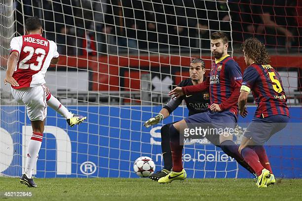 Danny Hoesen of Ajax goalkeeeper Jose Manuel Pinto of FC Barcelona Gerard Pique of FC Barcelona Carles Puyol of FC Barcelona during the Champions...