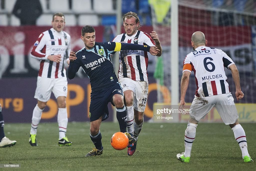 Danny Holla of ADO Den Haag, Niek Vossebelt of Willem II during the Dutch Eredivise match between Willem II and ADO Den Haag at the Koning Willem II Stadium on January 20, 2013 in Tilburg, The Netherlands.