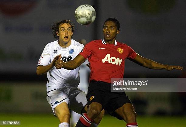 Danny Hylton of Aldershot Town and Luis Antonio Valencia of Manchester United