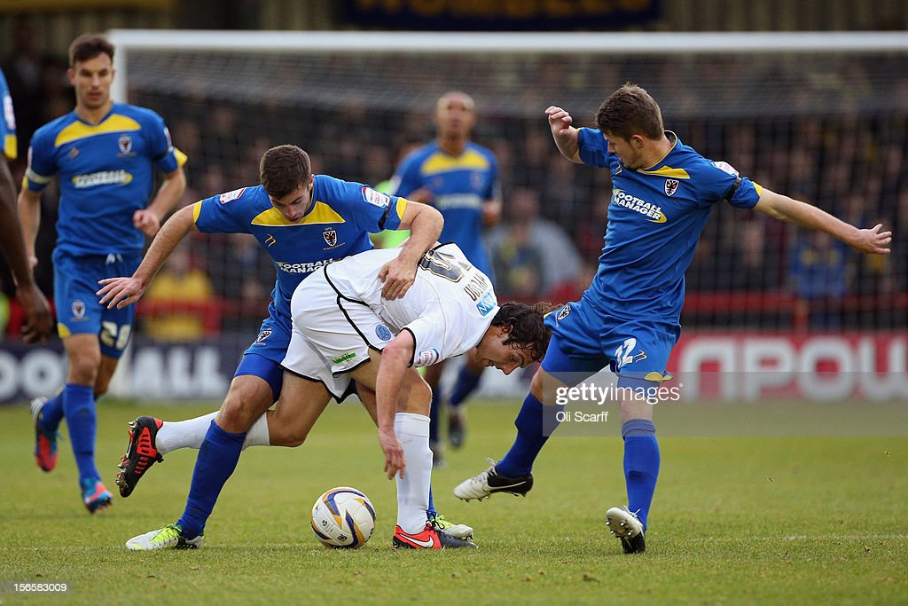 Danny Hylton (C) of Aldershot Town is challenged by AFC Wimbledon players during the npower League Two match between AFC Wimbledon and Aldershot Town at the Cherry Red Records Stadium on November 17, 2012 in Kingston upon Thames, England.