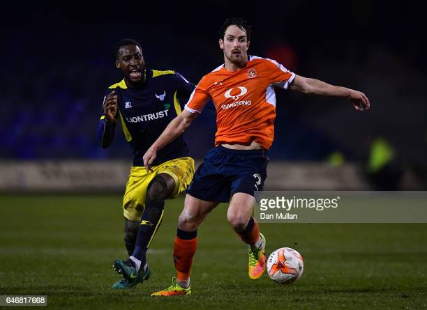 Danny Hylton of Luton Town holds off Cheyenne Dunkley of Oxford United during the EFL Checkatrade Trophy Semi Final match between Luton Town and...