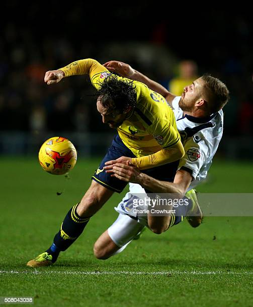 Danny Hylton of Oxford is fouled by Millwalls Mark Beevers during the Johnstone's Paint Trophy southern section semi final second leg match between...