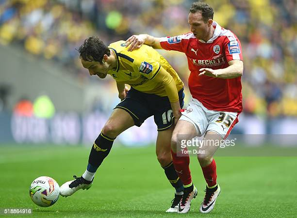 Danny Hylton of Oxford United and Aidan White of Barnsley in action during the Johnstone's Paint Trophy Final match between Oxford United and...