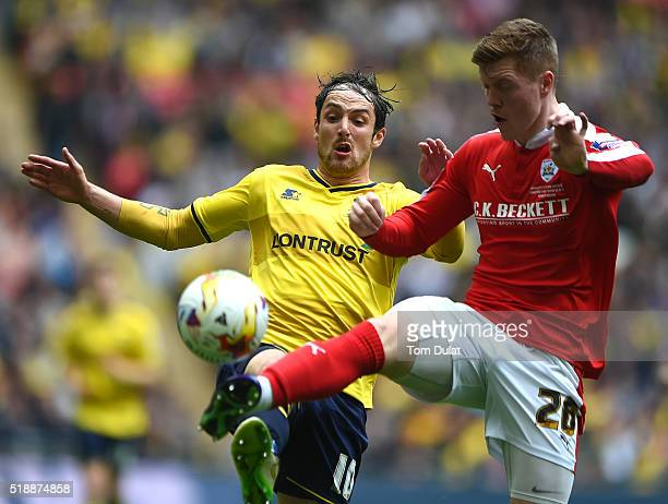 Danny Hylton of Oxford United and Alfie Mawson of Barnsley in action during the Johnstone's Paint Trophy Final match between Oxford United and...