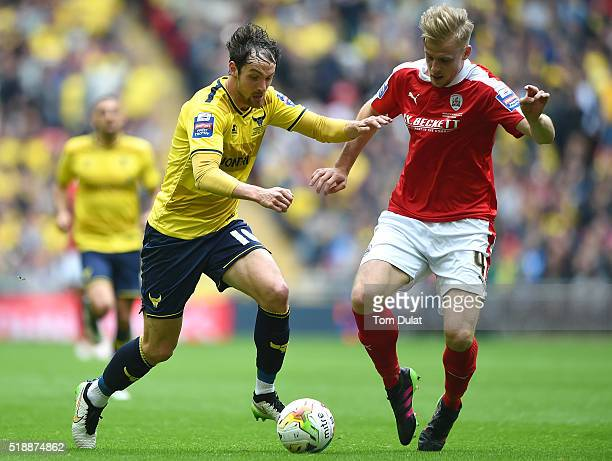 Danny Hylton of Oxford United and Marc Roberts of Barnsley in action during the Johnstone's Paint Trophy Final match between Oxford United and...