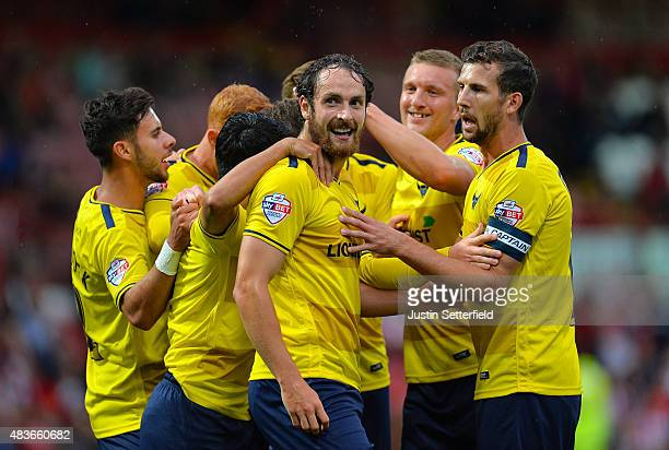 Danny Hylton of Oxford United celebrates scoring Oxfords 2nd goal during the Capital One Cup First Round match between Brentford and Oxford United at...