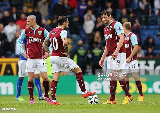 Danny Ings and Lukas Jutkiewicz of Burnley prepare to restart during the Barclays Premier League match between Burnley and Leicester City at Turf...