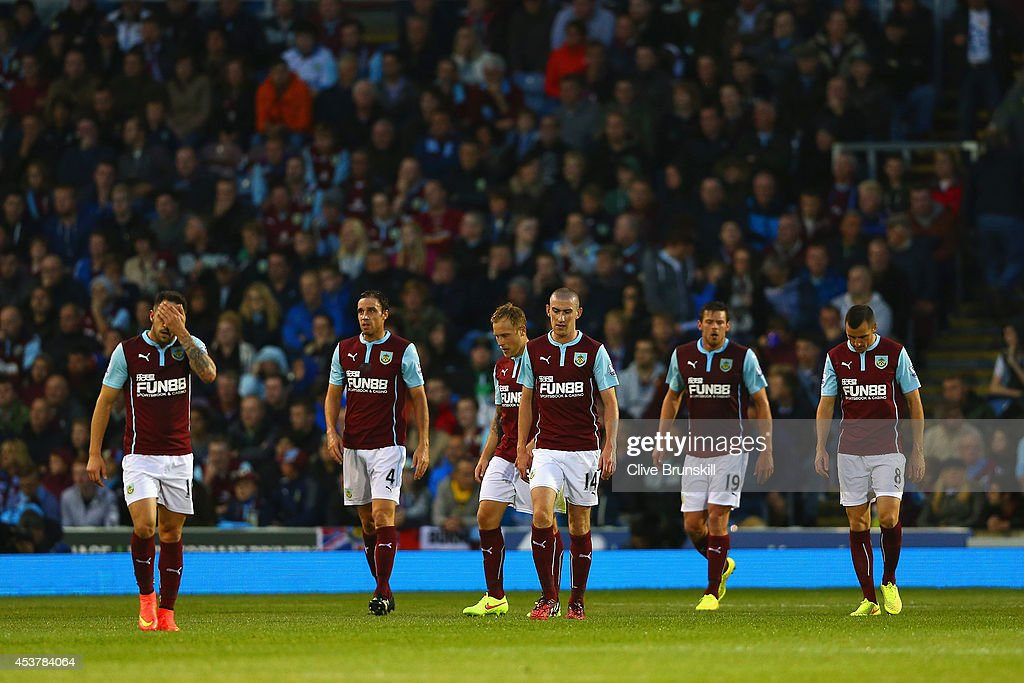 Danny Ings, Michael Duff, David Jones, Lukas Jutkiewicz and Dean Marney of Burnley look deejcted after conceding a third goal during the Barclays Premier League match between Burnley and Chelsea at Turf Moor on August 18, 2014 in Burnley, England.
