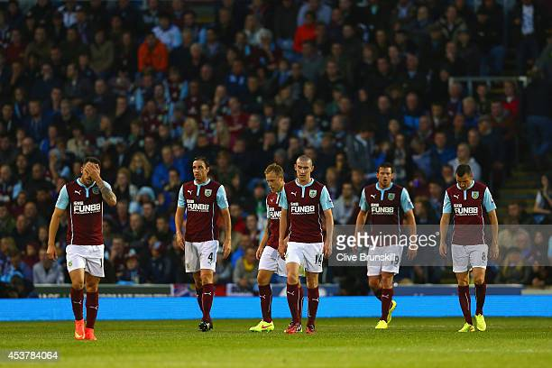 Danny Ings Michael Duff David Jones Lukas Jutkiewicz and Dean Marney of Burnley look deejcted after conceding a third goal during the Barclays...