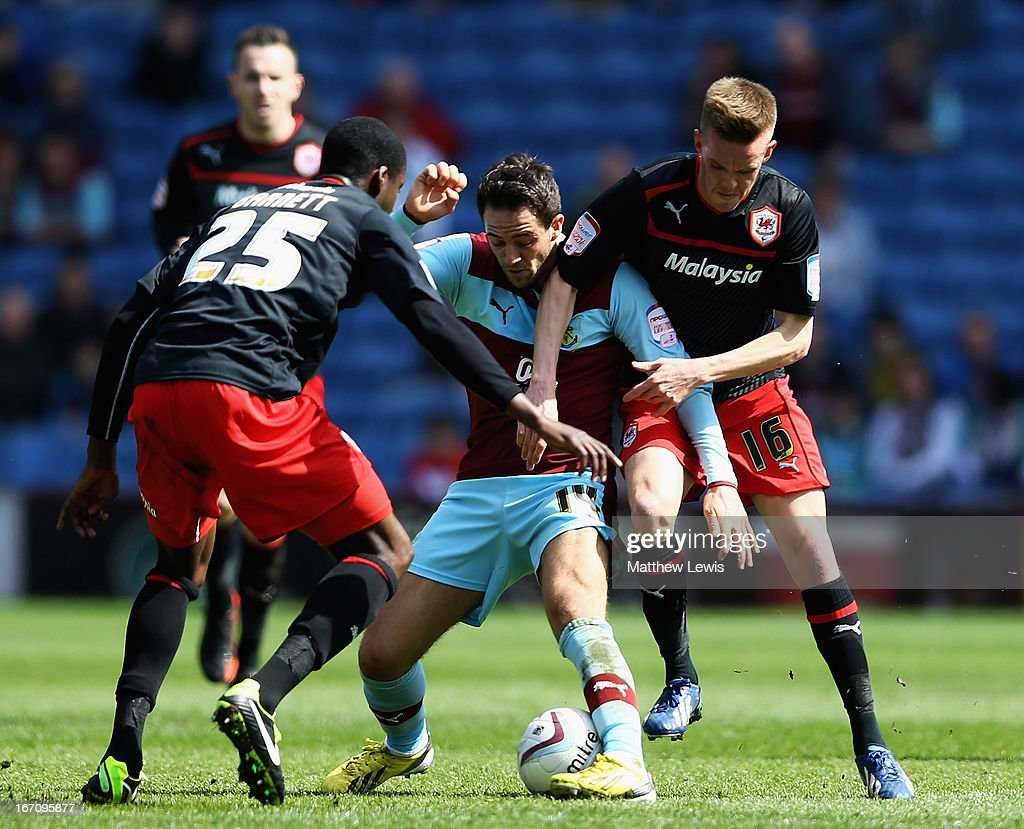 Danny Ings of Burnley and Craig Noone of Cardiff City challenge for the ball during the npower Championship match between Burnley and Cardiff City at Turf Moor on April 20, 2013 in Burnley, England.