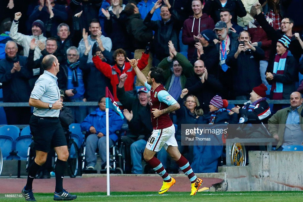 Danny Ings of Burnley (C) celebrates after scoring his second goal during the Sky Bet Championship match between Burnley and Queens Park Rangers at Turf Moor on October 26, 2013 in Burnley, England.