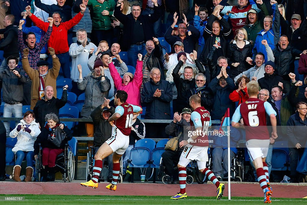 Danny Ings (L) of Burnley celebrates in front of the fans after scoring the opening goal of the Sky Bet Championship match between Burnley and Queens Park Rangers at Turf Moor on October 26, 2013 in Burnley, England.