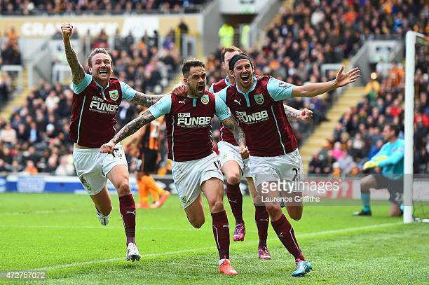 Danny Ings of Burnley celebrates scoring the opening goal with Matthew Taylor and George Boyd of Burnley during the Barclays Premier League match...