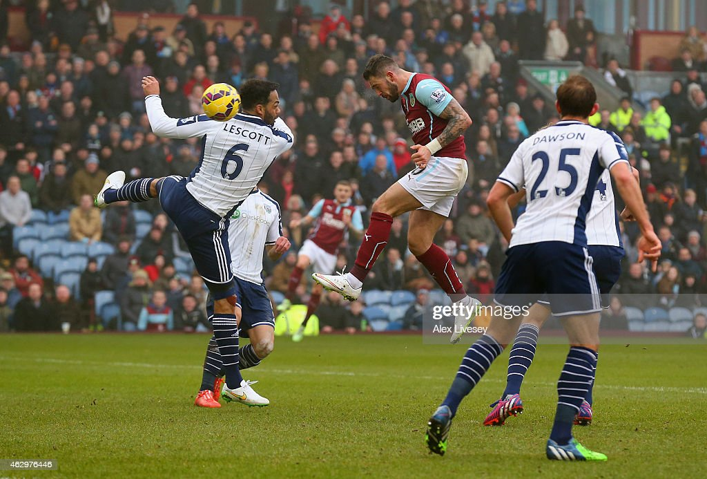 Danny Ings of Burnley heads in their second goal past Joleon Lescott of West Brom during the Barclays Premier League match between Burnley and West...