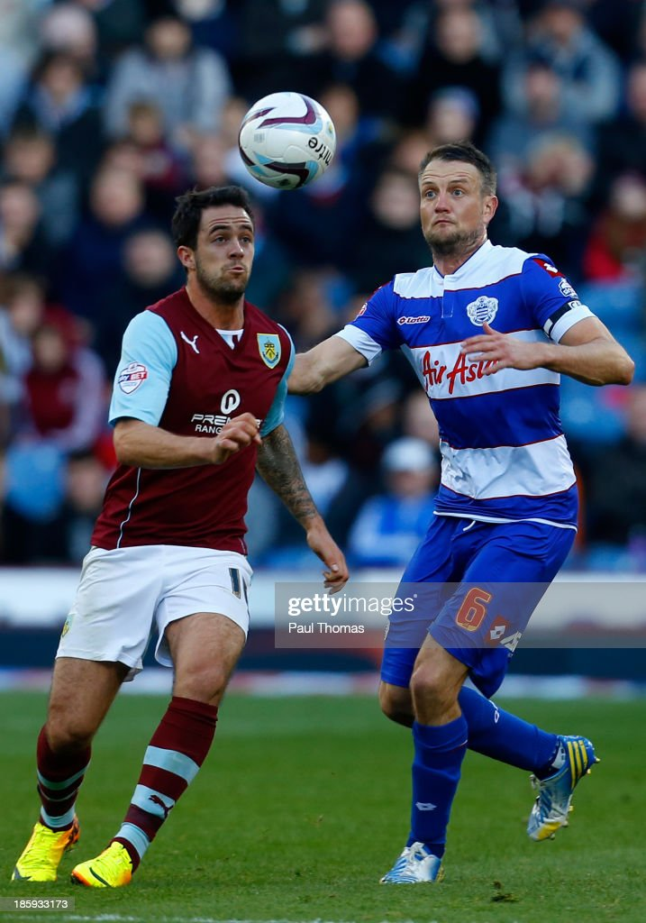 Danny Ings (L) of Burnley in action with Clint Hill of QPR during the Sky Bet Championship match between Burnley and Queens Park Rangers at Turf Moor on October 26, 2013 in Burnley, England.