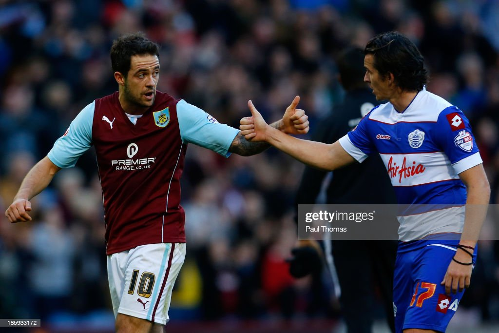 Danny Ings (L) of Burnley is congratulated by QPR's Joey Barton after the Sky Bet Championship match between Burnley and Queens Park Rangers at Turf Moor on October 26, 2013 in Burnley, England.