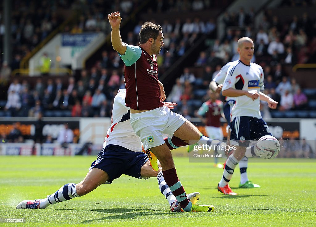 Danny Ings of Burnley scores the opening goal during the Sky Bet Championship match between Burnley and Bolton Wanderers at Turf Moor on August 03, 2013 in Burnley, England.