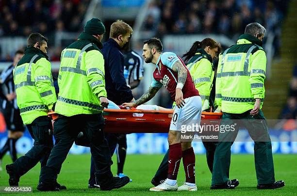 Danny Ings of Burnley shows concern as Kevin Long of Burnley is stretchered off injured during the Barclays Premier League match between Newcastle...