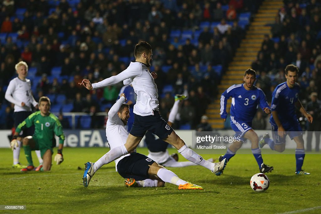 Danny Ings (GROUNDED) of England beats team mate <a gi-track='captionPersonalityLinkClicked' href=/galleries/search?phrase=Carl+Jenkinson&family=editorial&specificpeople=7935131 ng-click='$event.stopPropagation()'>Carl Jenkinson</a> to the ball to score his second goal of San Marin during the 2015 UEFA European U21 Championship Qualifying match between England U21 and San Marino U21 at Greenhous Meadow on November 19, 2013 in Shrewsbury, England.