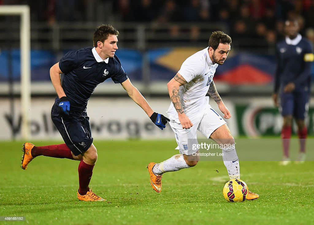 <a gi-track='captionPersonalityLinkClicked' href=/galleries/search?phrase=Danny+Ings&family=editorial&specificpeople=10650941 ng-click='$event.stopPropagation()'>Danny Ings</a> of England gets away from <a gi-track='captionPersonalityLinkClicked' href=/galleries/search?phrase=Aymeric+Laporte&family=editorial&specificpeople=7894319 ng-click='$event.stopPropagation()'>Aymeric Laporte</a> of France during the U21 International Friendly match between France and England at the Stade Francis Le Ble on November 17, 2014 in Brest, France.