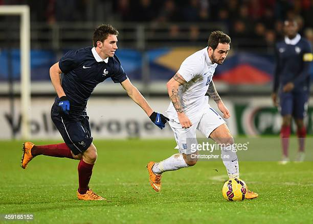 Danny Ings of England gets away from Aymeric Laporte of France during the U21 International Friendly match between France and England at the Stade...
