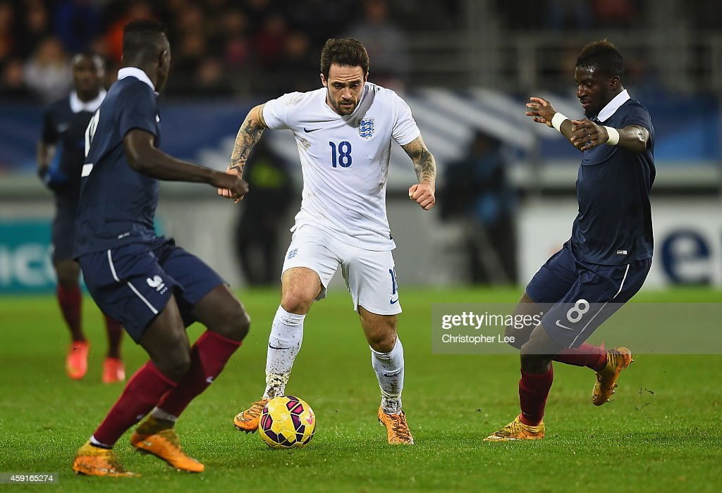 <a gi-track='captionPersonalityLinkClicked' href=/galleries/search?phrase=Danny+Ings+-+Soccer+Player&family=editorial&specificpeople=10650941 ng-click='$event.stopPropagation()'>Danny Ings</a> of England takes on Tiemoue Bakayoko and <a gi-track='captionPersonalityLinkClicked' href=/galleries/search?phrase=Benjamin+Mendy&family=editorial&specificpeople=7029850 ng-click='$event.stopPropagation()'>Benjamin Mendy</a> of France during the U21 International Friendly match between France and England at the Stade Francis Le Ble on November 17, 2014 in Brest, France.