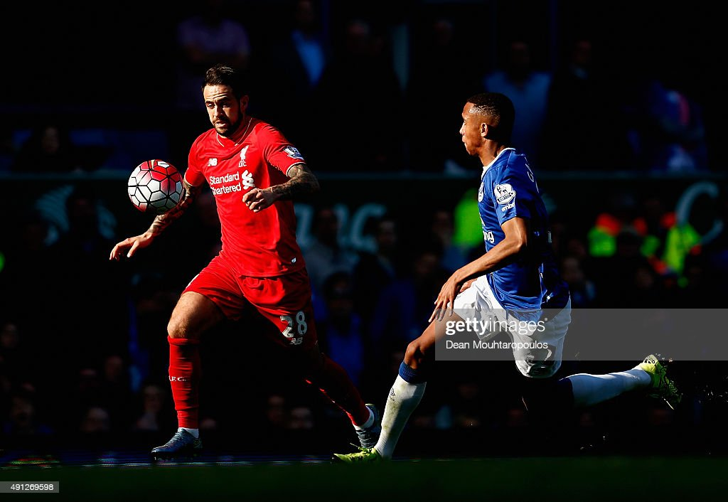Danny Ings of Liverpool and Brendan Galloway of Everton in action during the Barclays Premier League match between Everton and Liverpool at Goodison Park on October 4, 2015 in Liverpool, England.