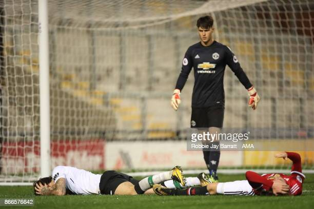 Danny Ings of Liverpool and Indy Boonen of Manchester United after a clash of heads during the Premier League 2 fixture between Manchester United and...