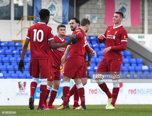 Danny Ings of Liverpool celebrates his third goal of the game with team mates Ovier Ejaria Cameron Brannagan Jon Flanagan and Lloyd Jones during the...