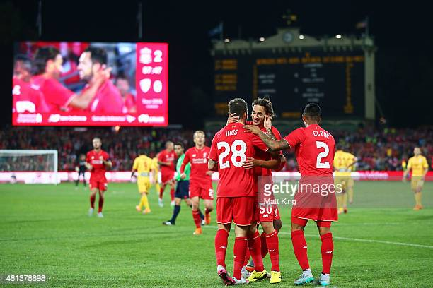 Danny Ings of Liverpool celebrates with team mates after scoring the second goal during the international friendly match between Adelaide United and...