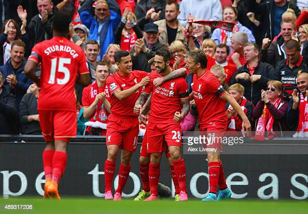 Danny Ings of Liverpool celebrates with team mates as he scores their first goal during the Barclays Premier League match between Liverpool and...