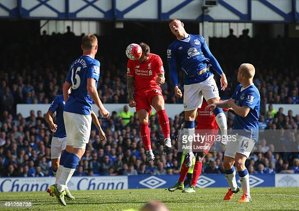 Danny Ings of Liverpool scores Liverpool's first goal during the Barclays Premier League match between Everton and Liverpool at Goodison Park on...